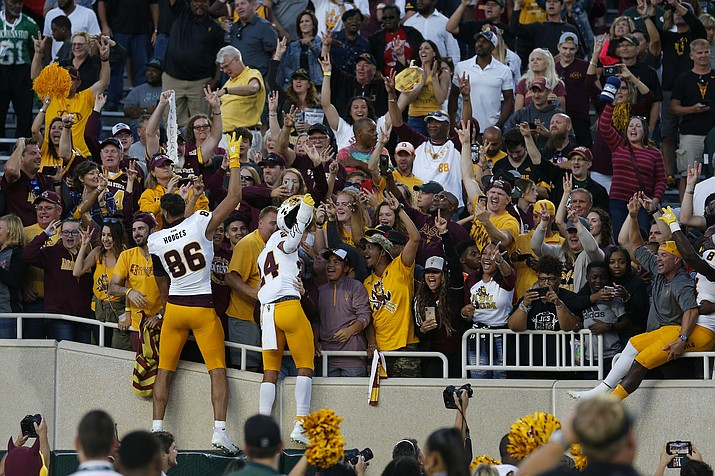 Arizona State players celebrate with fans following an NCAA college football game against Michigan State, Saturday, Sept. 14, 2019, in East Lansing, Mich. (Al Goldis/AP)