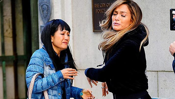 Constance Wu, left, and Jennifer Lopez appear in Hustlers. (IMDb photo)