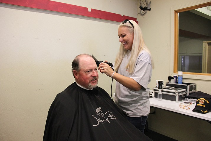 Marine corps veteran Tim Roeder gets a free haircut from Dawn Zimmerman during the Yavapai County Stand Down event at the Frontier Village Shopping Center Saturday, Sept. 14, 2019. The two-day event is hosted annually by U.S. Vets, community partners and service providers to provide veterans with comprehensive services such as VA enrollment, legal assistance, medical screenings, clothing and showers. (Max Efrein/Courier)