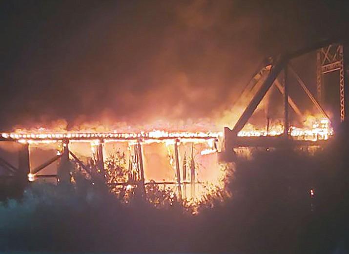 The Arizona and California Railroad's bridge over the Colorado River at Parker caught fire Saturday night. (Today's News-Herald/Emily Panuco courtesy photo)