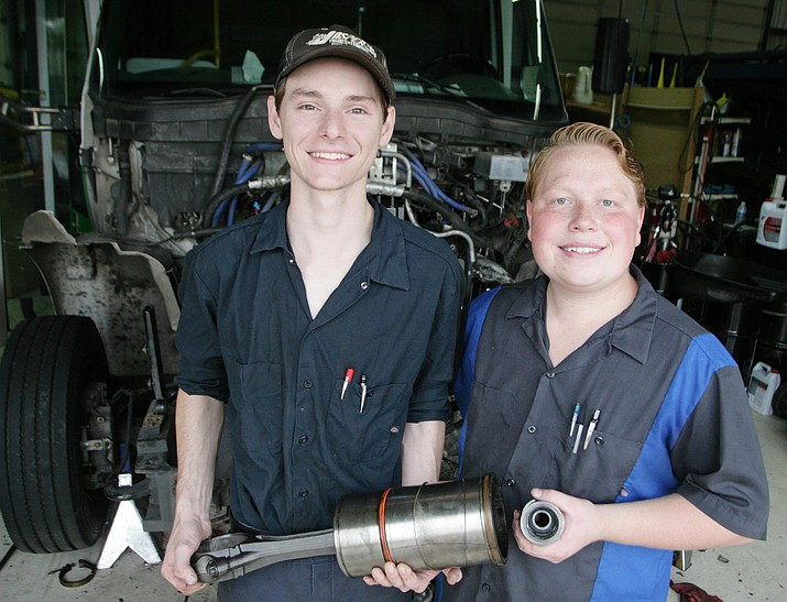 Ryan Rozeboom, left, and Shawn Mayo, graduates of Mingus Union High School, work at Hansen Enterprises Fleet Repair. The friends would one day like to own and operate their own repair shop. VVN/Bill Helm