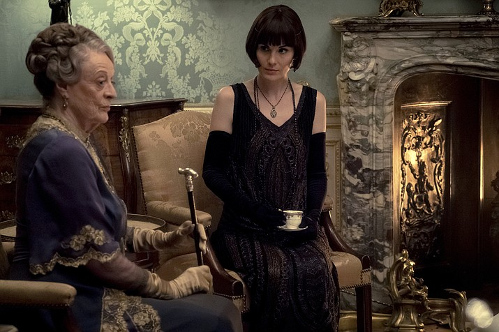 "This image released by Focus Features shows Dame Maggie Smith as The Dowager Countess of Grantham and Michelle Dockery as Lady Mary Talbot in ""Downton Abbey"". (Jaap Buitendijk/Focus Features via AP)"