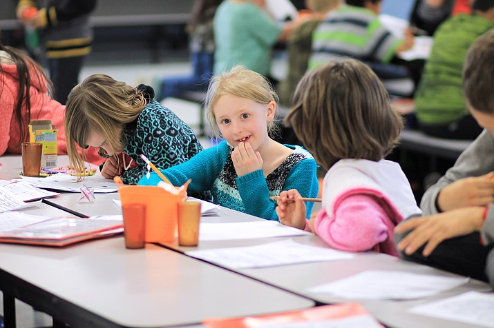Students work on homework and other projects in an after-school program at Williams Elementary-Middle School in 2017. The school has recently received a grant to reinstate the program. (Wendy Howell/WGCN)