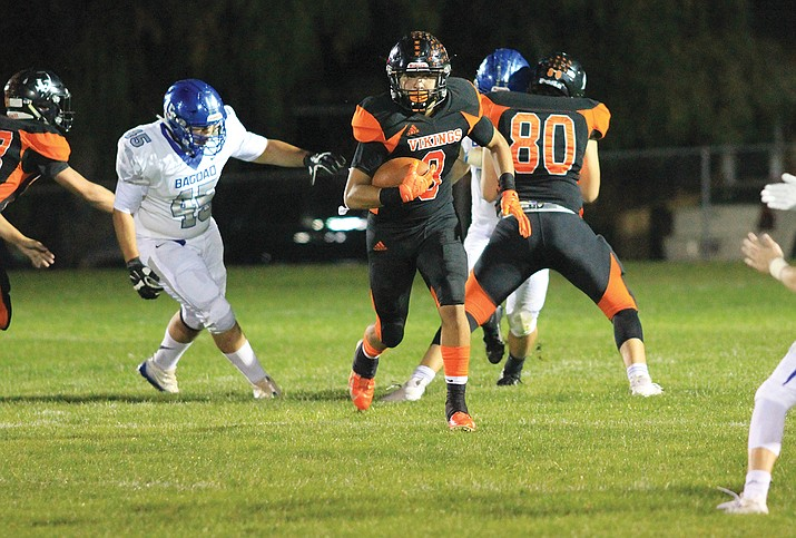 Viking David Lozano takes the ball down field during the game with the Bagdad Sultans Sept. 13. The Vikings handed the Sultans a 66-20 loss.  (Wendy Howell/WGCN)