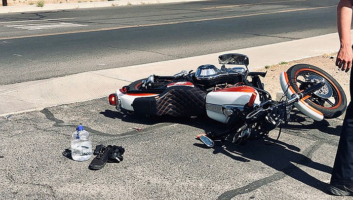 The motorcycle operator was unable to avoid the truck and crashed into its right, front side. He sustained serious injuries to his leg and was transported to KRMC. (Photo by Agata Popeda/Daily Miner)