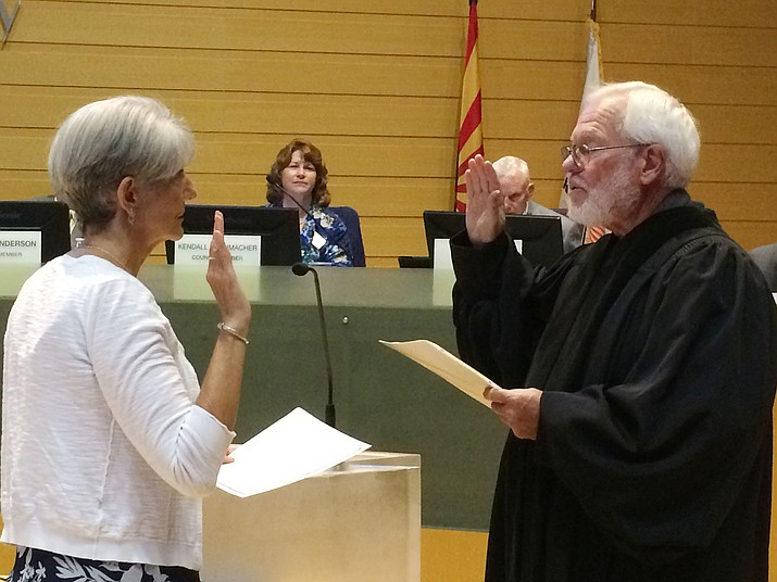Judge Keith Carson, Prescott Valley magistrate, issues the Oath of Office to Prescott Valley's newest town council member, Lori Hunt, at the Sept. 12 council meeting in the auditorium/council chambers of the Prescott Valley Public Library. (Sue Tone/Tribune)