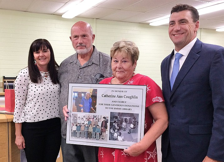 Carol Weinrich holds the framed sign with photographs of her late sister, Catherine Coughlin, a teacher, honoring Coughlin and her family for donating to Bradshaw Mountain Middle School, at the Sept. 10 HUSD Governing Board meeting. From left are BMMS Principal Jessica Bennett, Gary and Carol Weinrich, and HUSD Superintendent Dan Streeter. (Sue Tone/Tribune)