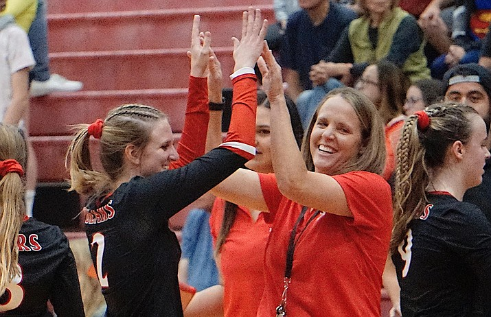 Bradshaw Mountain volleyball head coach Karrie Platt (right) high-fives senior MH McKyrie Herb during a timeout in a game against Prescott on Thursday, Sept. 12, 2019, at Bradshaw Mountain High School. (Aaron Valdez/Courier, File)