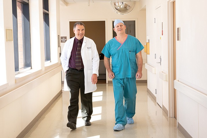 Dr. Alan Waters, surgeon, on the right in blue scrubs, and pharmacist Glenn Currier in a white lab coat on the left. (YRMC/Courtesy)