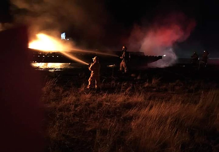 Ash Fork Fire Department, Kaibab Estates West Fire and Seligman Fire work to extinguish a fully engulfed semi trailer on I-40 Sept. 12. (Melvin Stump/Kaibab Estate West Fire)