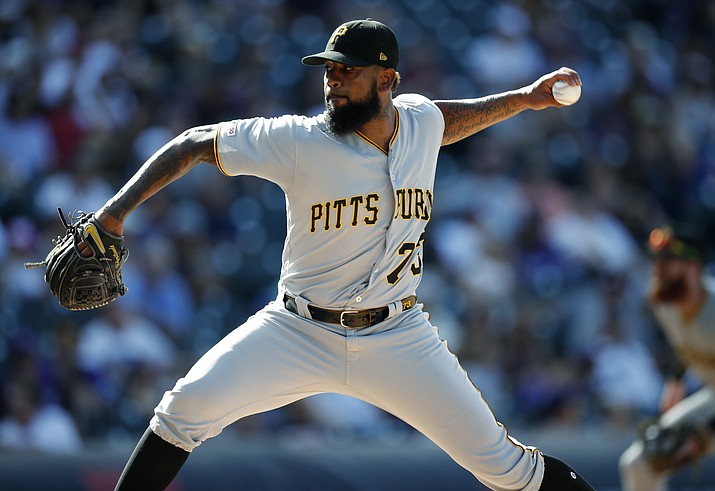 In this Sept. 1, 2019, photo, Pittsburgh Pirates pitcher Felipe Vazquez works against the Colorado Rockies in the ninth inning of a baseball game in Denver. Pirates All-Star closer Felipe Vazquez has been arrested on charges of pornography and soliciting a child. Vazquez was taken into custody Tuesday morning, Sept. 17, 2019, by Pennsylvania State Police on one count of computer pornography/solicitation of a child and one count of providing obscene material to minors. (David Zalubowski/AP, File)