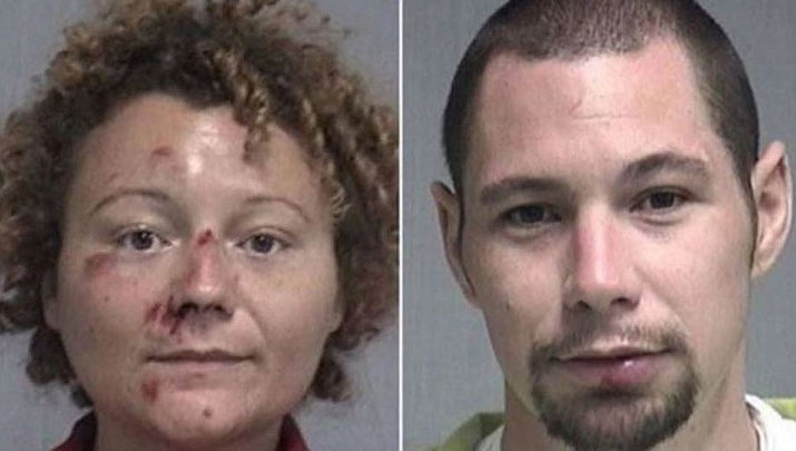 Authorities say a man and a woman who were stopped for drunken bicycling in a Florida beach town had sex in a deputy's patrol car before one of them fled naked. (Fernandina Beach Police Department)