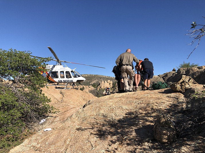 An Arizona Department of Public Safety Ranger helicopter lands to airlift 67-year-old Paul Richards to a local hospital after he was found around 3:30 p.m. Thursday, Sept. 19, 2019. (PPD/Courtesy)