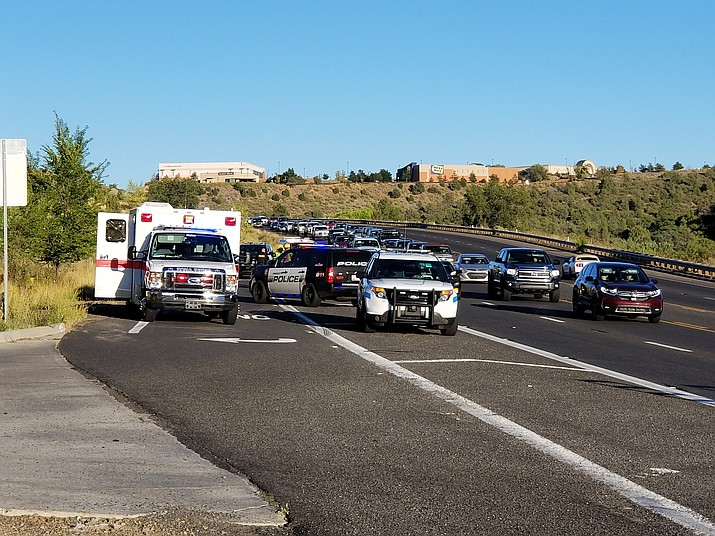 Multiple police vehicles and an ambulance sit parked at the scene of an accident on Highway 69 between Prescott Lakes Parkway and the Yavpe Connector on Thursday, Sept. 19, 2019. A man was hit by a sedan after attempting to cross Highway 69. (Max Efrein/Courier)