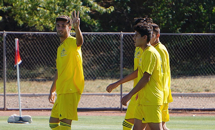 Yavapai men's soccer forward Paul Fulop (left) holds up three fingers to signify his hat-trick after scoring his third goal in the Roughriders' 5-0 win over Glendale on Thursday, Sept. 19, 2019, at Mountain Valley Park in Prescott Valley. (Aaron Valdez/Courier)