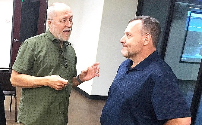Camp Verde Business Alliance President B. J. Davis, left, talks with Tim Remick of Remick West-Watt PLC in January. The  Business Alliance has no plans to rebrand itself as the Camp Verde Chamber of Commerce, but it does own the rights to that name. File photo
