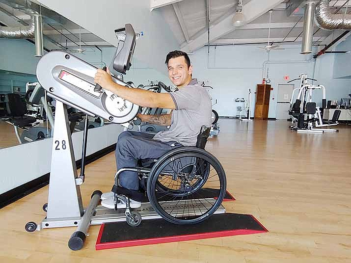 New Horizons Disability Empowerment Center's Andrew Bogdanov works out Sept. 12 on a Sci-Fit exercise machine, which is specially designed for disabled people.