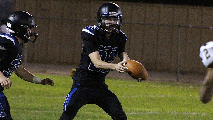 Kingman Academy's Charlie Anderson threw for 226 yards and five touchdowns Friday night in a 65-22 victory over Coronado. (Daily Miner file photo)