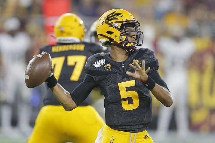 Arizona State quarterback Jayden Daniels throws for a first down against Colorado during the first half of an NCAA college football game Saturday, Sept. 21, 2019, in Tempe, Ariz. (Rick Scuteri/AP)