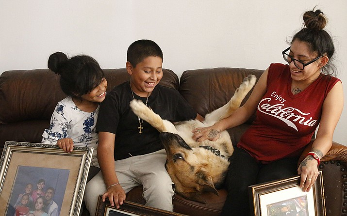 Max, the family dog, joined Guadalupe, Jose and Stacy in their new home. The Molina family's recent move provides an uplifting change of scenery after their mother's arrest. (Annika Tomlin/Cronkite News)