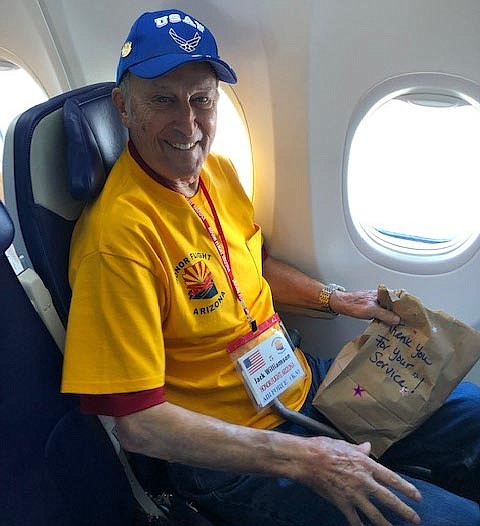 Jack Williamson is shown with his sack lunch on the Honor Flight, a trip for veterans to Washington, D.C., to view the military memorials. (Courtesy)