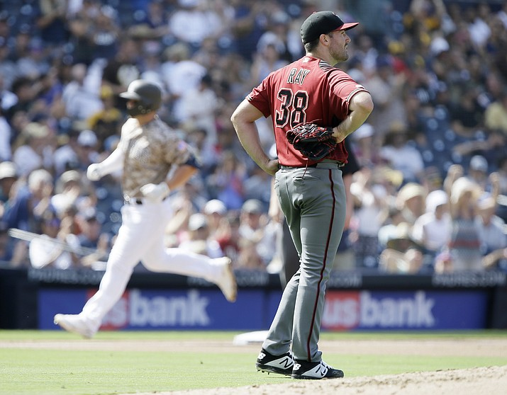 Arizona Diamondbacks starting pitcher Robbie Ray, right, looks away as San Diego Padres' Ty France rounds the bases after hitting a two-run home run during the fourth inning Sunday, Sept. 22, 2019. (Alex Gallardo/AP)