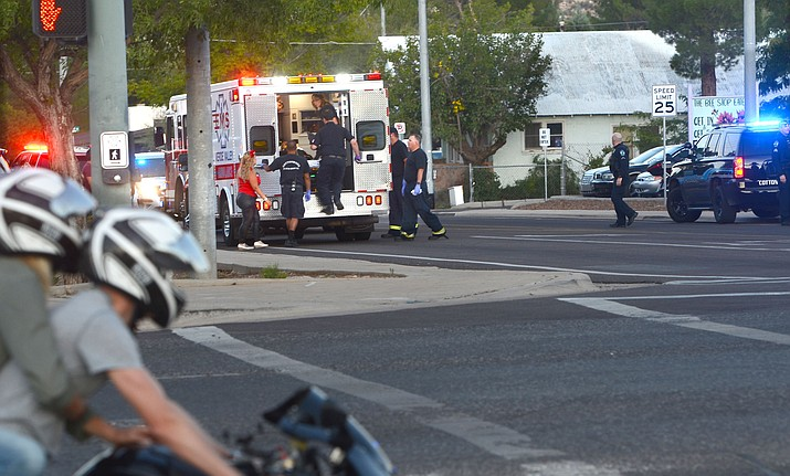 "Emergency responders place an assault victim in an ambulance Saturday near the entrance of Main Street and Mingus Avenue. There were no arrests as ""The other driver left prior to law enforcement's arrival and we do not have any information on who that was,"" said Cottonwood PD Sgt. Monica Kuhlt. VVN/Vyto Starinskas"