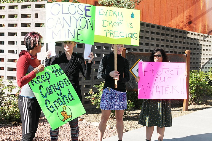 Protesters gather in front of Coonino Community College Sept. 17 to try to convince ADEQ not to renew an aquifer permit for Canyon Mine, and to hold a public hearing on the matter. (Erin Ford/WGCN)