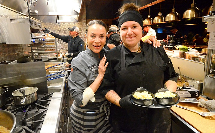 Butterfly Burger owner Lisa Dahl and employee Drew Biale at the restaurant's soft opening Monday. VVN/Vyto Starinskas