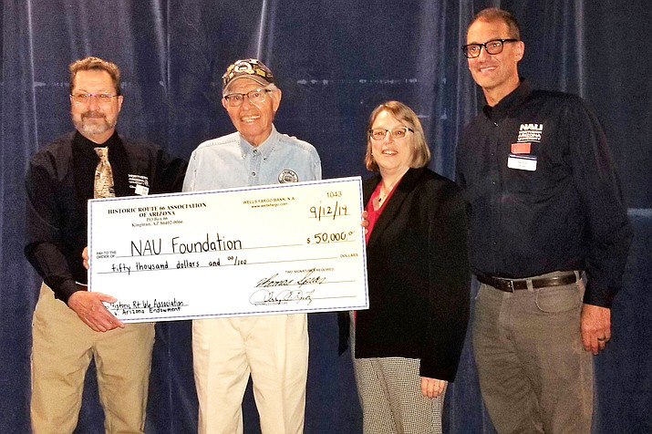 Angel Delgadillo (second from left) joins other members of the Historic Route 66 Association as the present a check to Northern Arizona University. (Photo/Route 66 Association)