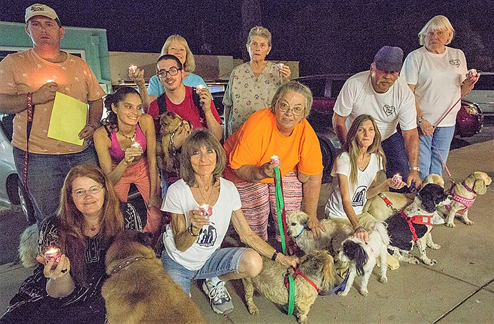 Participants gather at the 2018 Remember Me ceremony at For the Luv of Paws animal rescue and sanctuary. (For the Luv of Paws courtesy photo)