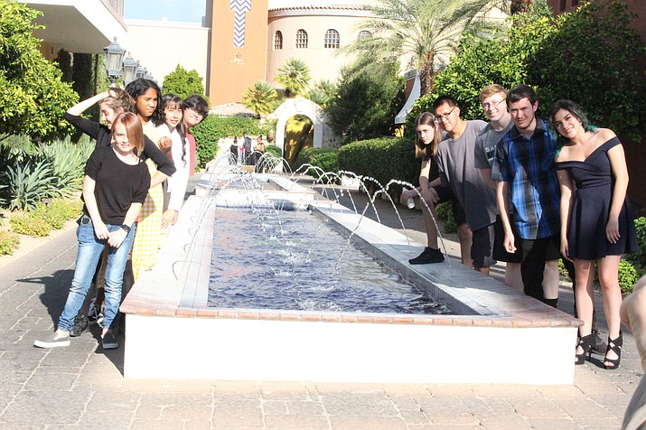 Micah Hines joins his classmates at one of the many water fountains at the Omni Resort in Scottsdale where they attended the Rocky Mountain Emmy Awards. From left, back to front, Keller Jackson, Stacy Beltran, Madison Rhoton, Adrionna Jones and Jordan Kozlowski; and (right side) Ethan Clark, Micah Hines, Tristan Wright, Roman Sandoval and Edith Zuhlke. (Stan Bindell/NHO)