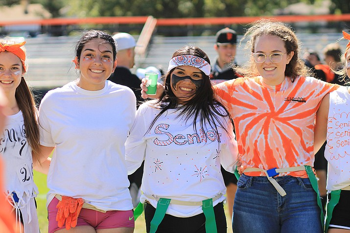 Williams High School students Jazlyn Romero, Mikayla Sanders and Alaina Karlsberger enjoy activities on the football field during homecoming last week. (Wendy Howell/WGCN)