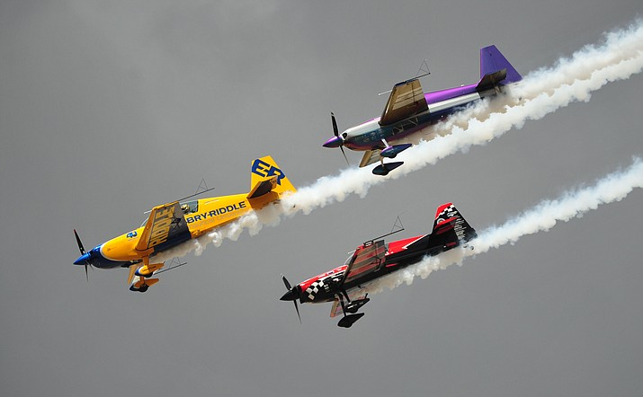 Shown here is Matt Chapman, Bill Stein and Rob Holland performing aerial acrobatics at the 2018 Wings Out West Airshow. They will perform again in this years show at Prescott Regional Airport Saturday, Oct. 5. (Les Stukenberg/Courier)