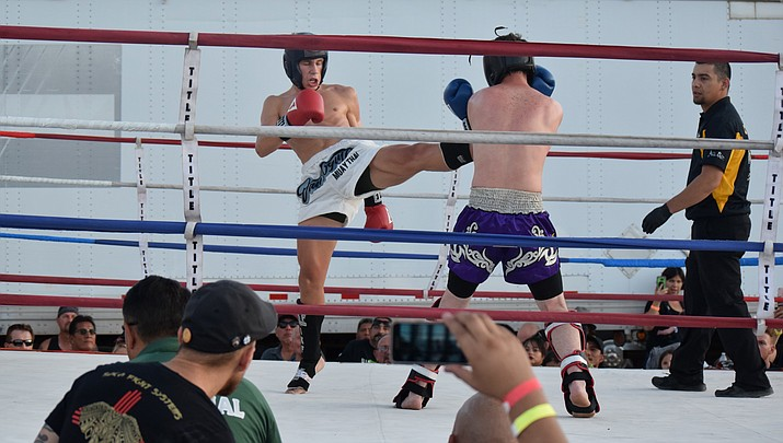 Evan Dion from Mesa kicks Tyler Brown of Camp Verde during the adult amateur welter weight title fight on Saturday at THAT Brewery. Dion won by unanimous decision. VVN/James Kelley