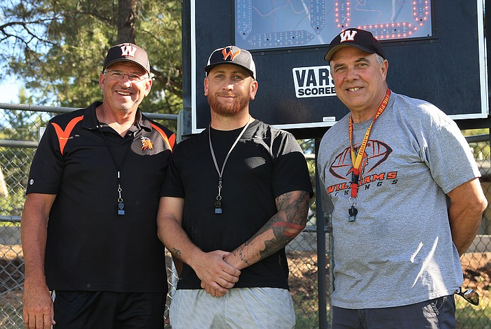Vikings head football coach Jeff Brownlee (left) was selected as the Arizona Cardinals Coach of the Week last week. Also pictured are coaches Ryan Ward and Tad Wygal. (Wendy Howell/WGCN)