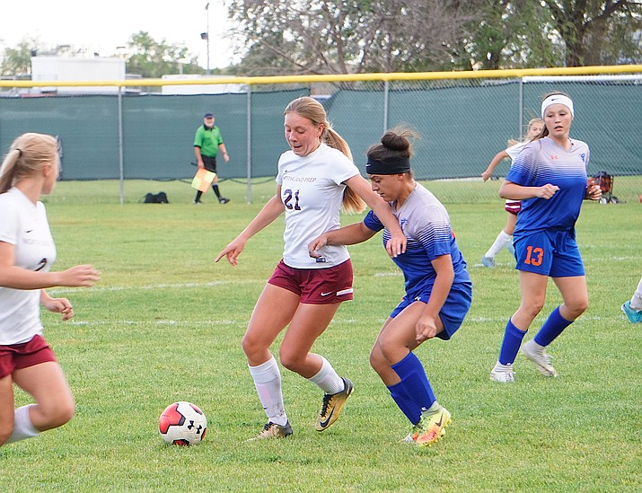 Chino Valley defender Carolina Gomez defends striker Sydney Sventek during the team's 5-3 overtime loss to Northland Prep on Thursday, Sept. 26, 2019, at Chino Valley High School. (Aaron Valdez/Courier)