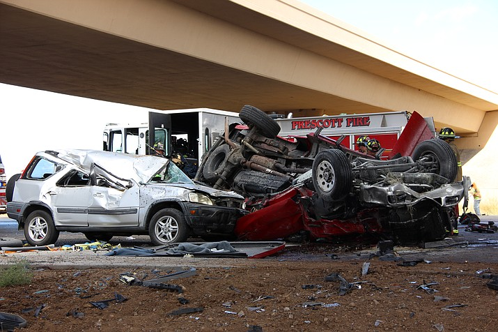 A red truck and silver compact SUV lie battered in the southbound lane of Highway 89 Friday afternoon, Sept. 27, 2019. The driver of the truck was declared dead at the scene. (Max Efrein/Courier)