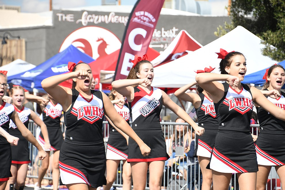 Lee Williams Cheerleading squad bringing Volunteer pride at the 2019 Andy Devine Days parade. (Photo by Vanessa Espinoza/Daily Miner)