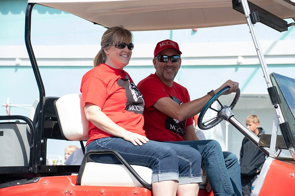 Mohave Community College President Stacy Klippenstein, and his wife Carrie lead the MCC team through the 49th annual Andy Devine Days Parade Saturday, Sept. 28, 2019. (Photo by Vanessa Espinoza/Daily Miner)