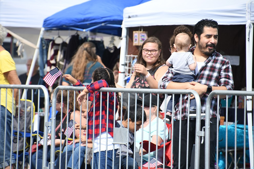 Spectators enjoyed the various community organizations riding through on Beale Street for the 49th annual Andy Devine Days Parade. Some of the organizations were Mohave County Sheriff's Office, Kingman Fire Department, youth football teams and more. (Photo by Vanessa Espinoza/Daily Miner)