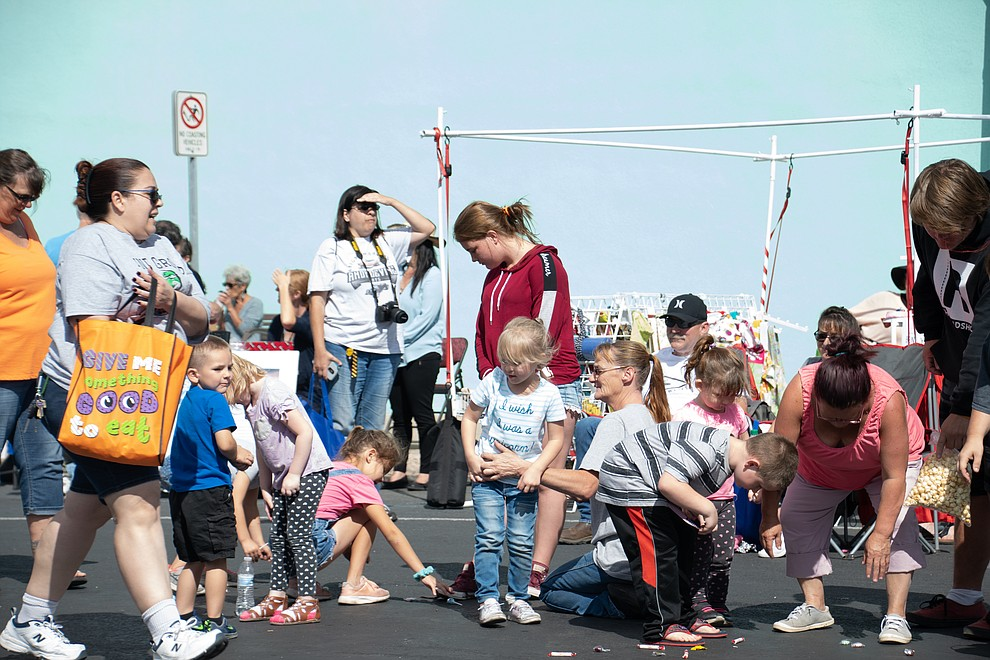 Children picking up candy at the 49th annual Andy Devine Days Parade. (Photo by Vanessa Espinoza/Daily Miner)