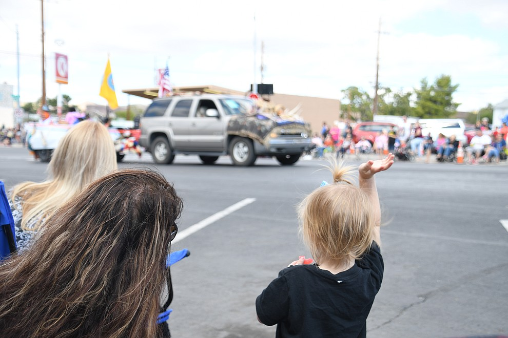 Street were filed with families watching and waving at people participating in the 2019 Andy Devine Days Parade. (Photo by Vanessa Espinoza/Daily Miner)