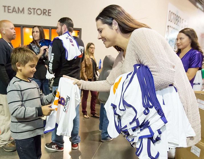 Ashley Stovall, seen here handing out a jersey to a child at Findlay Toyota Center, was promoted to vice president of business operations for the Northern Arizona Suns, the NBA G League pro basketball team in Prescott Valley, on Sept. 23. (Courtesy/Matt Hinshaw, file, Northern Arizona Suns)