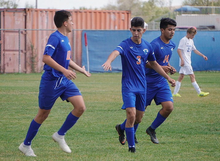 Chino Valley's Gabe Castillo (10), Orlando Santoyo (3) and Angel Sanchez (14) celebrate after Santoyo scored a goal the team's 8-2 win over Desert Christian on Saturday, Sept. 28, 2019, at Chino Valley High School. (Aaron Valdez/Courier)