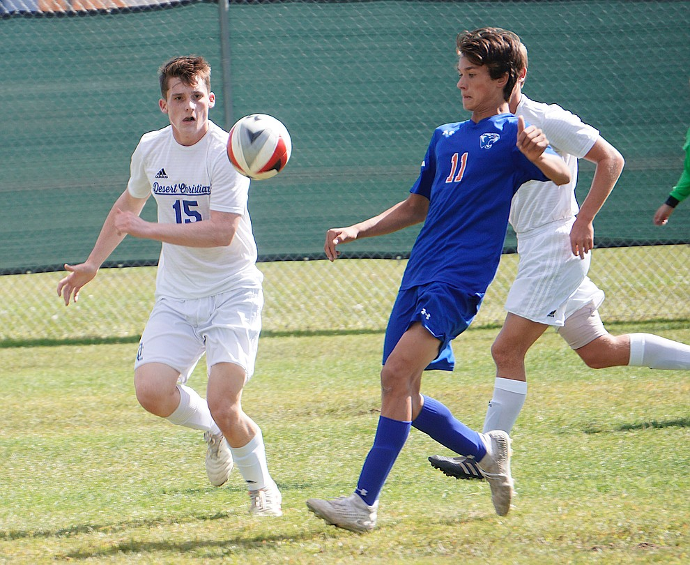 Chino Valley midfielder Quade Kellerman (11) corrals the ball between two defenders during the team's 8-2 win over Desert Christian on Saturday, Sept. 28, 2019, at Chino Valley High School. (Aaron Valdez/Courier)