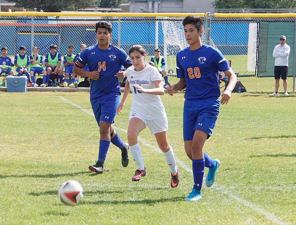 Chino Valley defender Ricardo Juarez-Flores (20) dishes off a pass during the team's 8-2 win over Desert Christian on Saturday, Sept. 28, 2019, at Chino Valley High School. (Aaron Valdez/Courier)