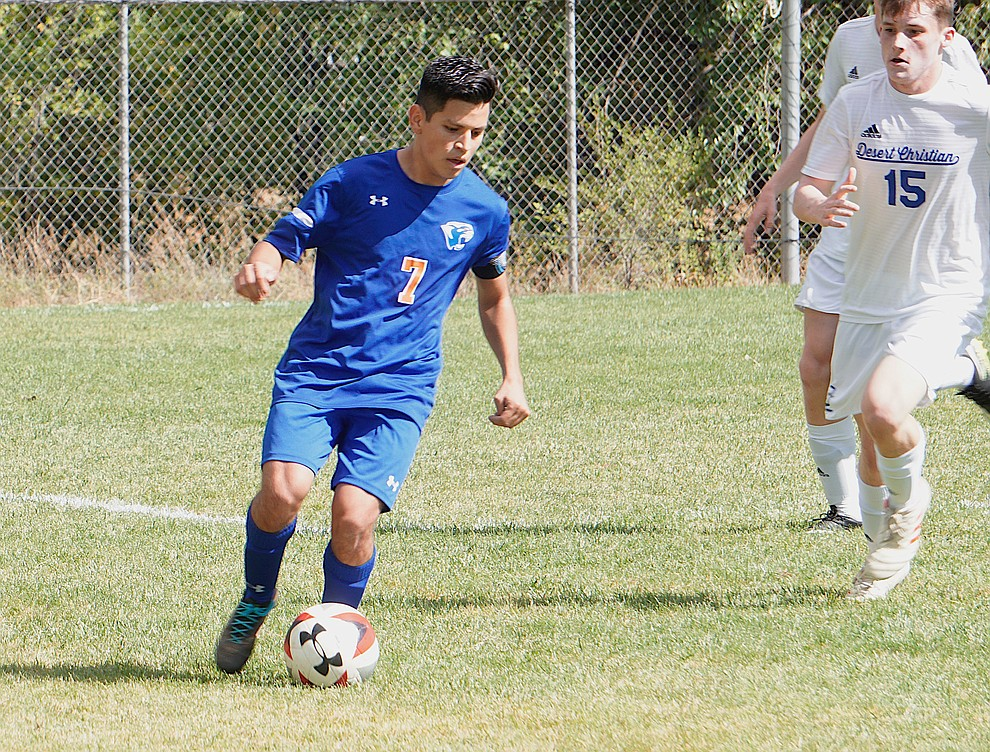 Chino Valley forward Irving Vedolla (7) probes the left flank during the team's 8-2 win over Desert Christian on Saturday, Sept. 28, 2019, at Chino Valley High School. (Aaron Valdez/Courier)