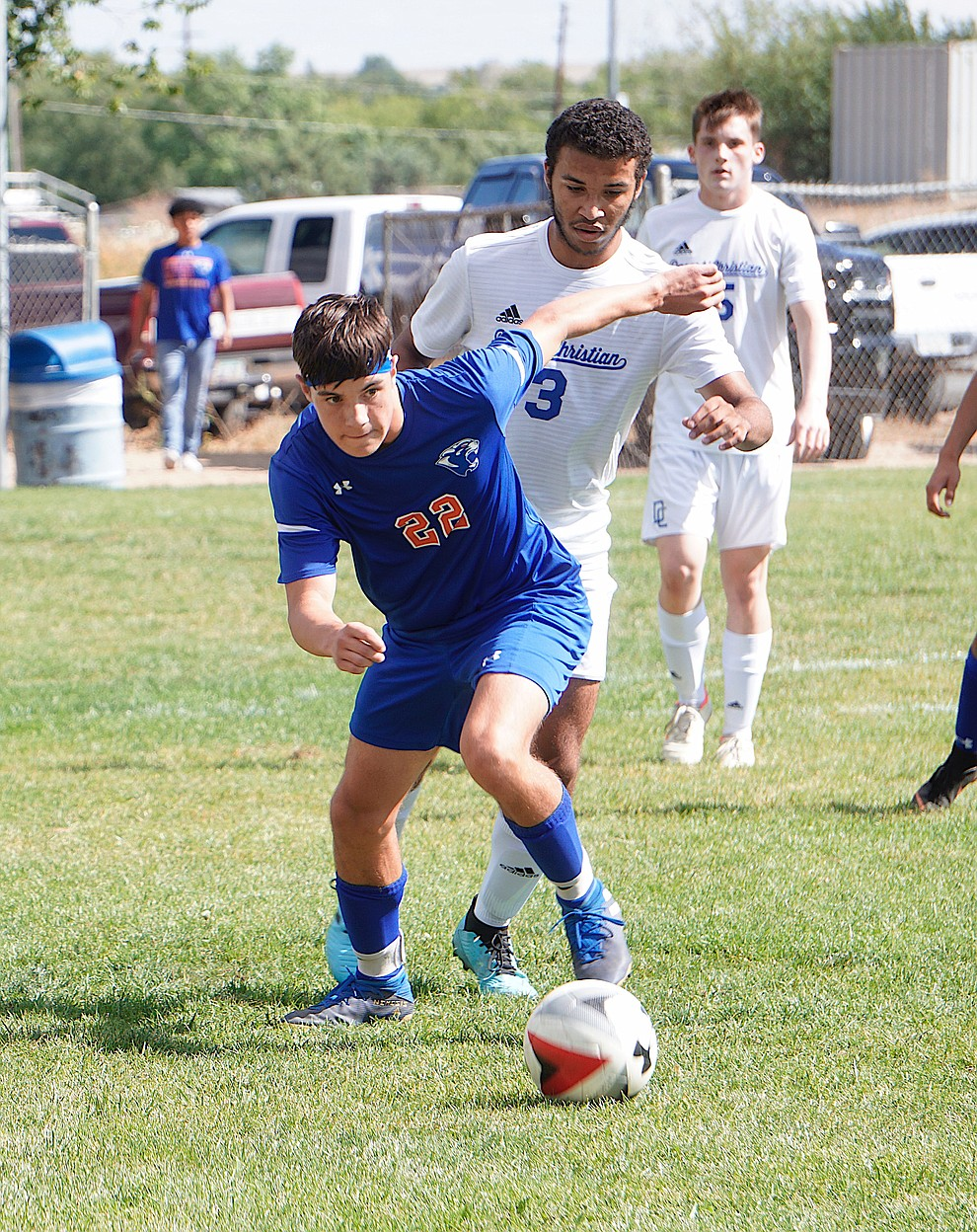 Chino Valley defender Ravi Holladay (22) gets past his defender during the team's 8-2 win over Desert Christian on Saturday, Sept. 28, 2019, at Chino Valley High School. (Aaron Valdez/Courier)