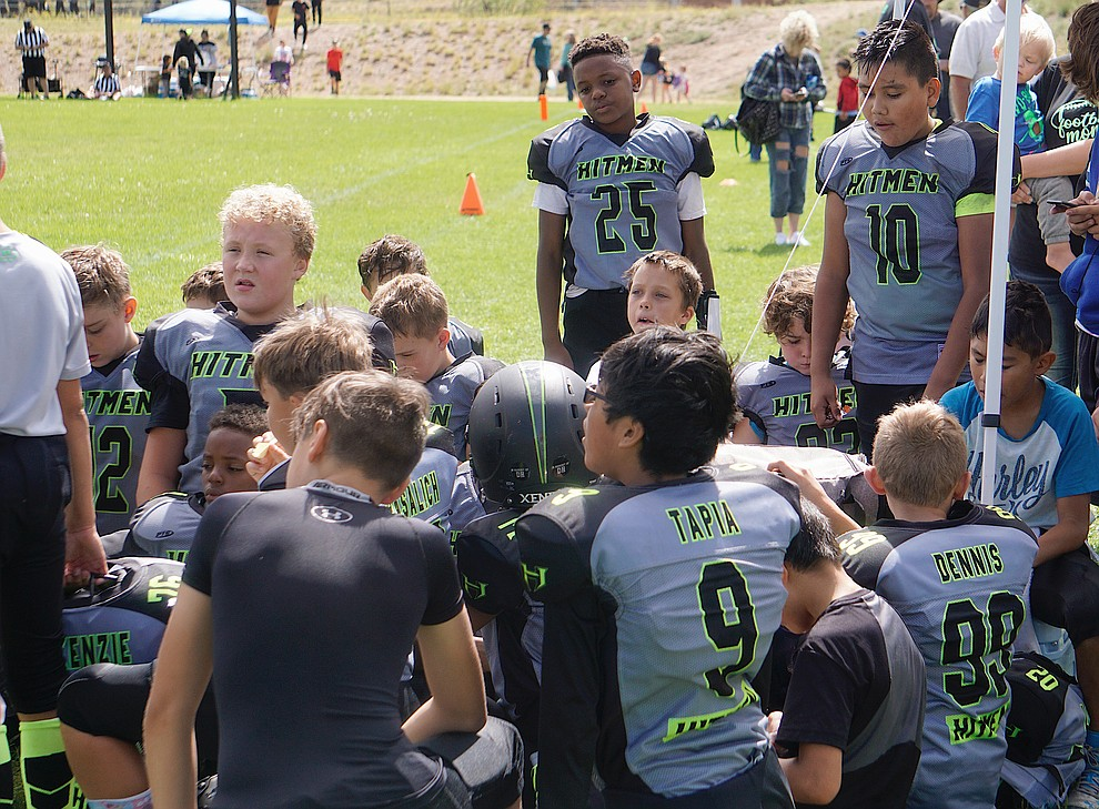The Prescott Valley Hitmen minors team huddles up after their game against Bagdad on Saturday, Sept. 28, 2019, at Bradshaw Mountain Middle School. (Aaron Valdez/Courier)